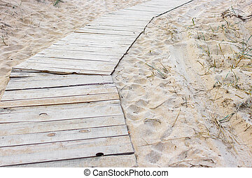 Sand on a wooden path