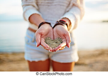 Sand on palms