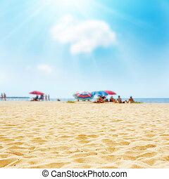 sand on the beach and sun in blue sky