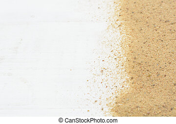 Sand on white wooden background with copy space