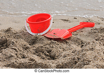 Sand Pail and Shovel - Red Sand Pail and Shovel on a beach