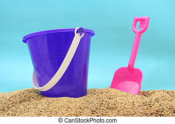 Sand Pail with Pink Shovel at Beach