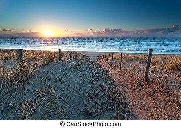 path no North sea beach at sunset