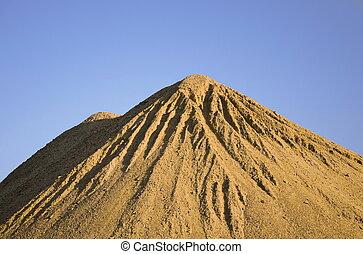 Sand pile with blue sky