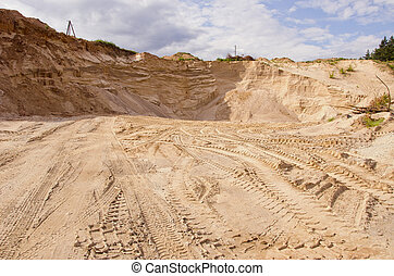 Sand pit. Sand special for construction. Pit full of fine sand and truck tracks.