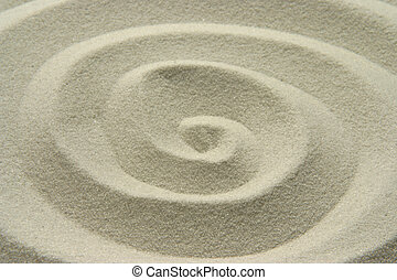 sand spiral - spiral design traced in sand