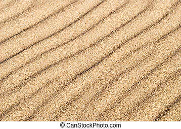 yellow sand with wave drawing as a texture or background