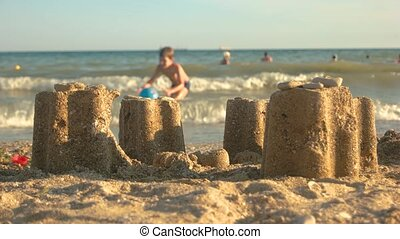 Sand towers on seashore.