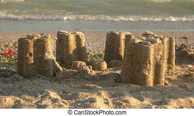 Sand towers on the beach.