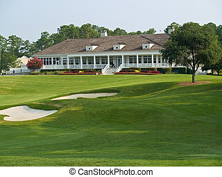 Sand Trap and Clubhouse - A view over the sand traps towards...