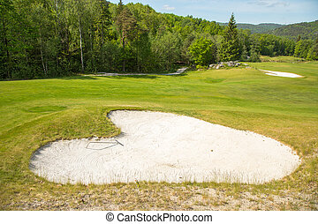 Sand trap in a golf course sand bunkers heart shape