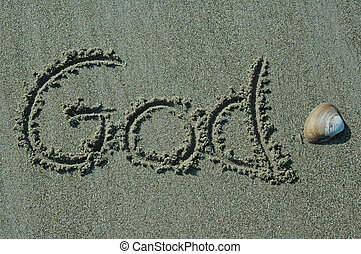 God written in sand with shell accent