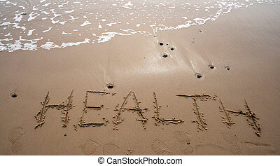 The word HEALTH written in sand next to the shore