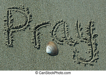 Sand Writing - Pray - Pray written in sand with shell accent