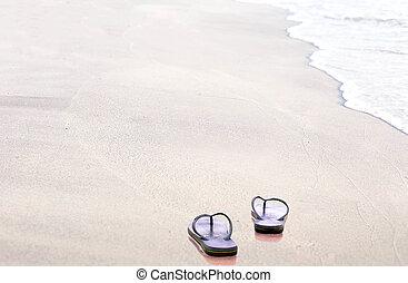 Sandals flip flops on the beach