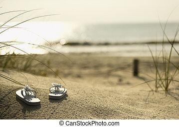 Sandals on beach.
