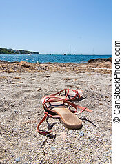 Sandals on sandy beach