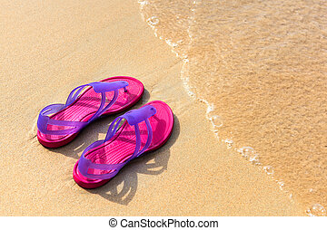 Sandals on the beach - concept image