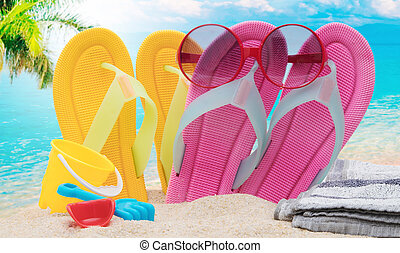 sandals with sunglasses on the beach
