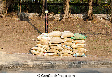 Sandbag  - The sandbag are stacked on the floor.