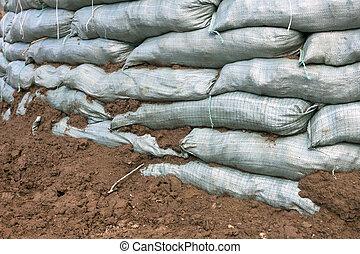 Sandbags for flood protection. Temporary dam