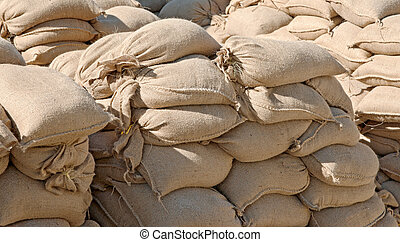 sandbags in pile - lots of sandbags all piled ready and...