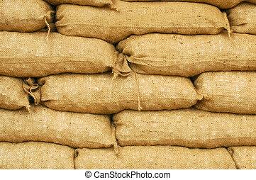 sandbags - background of sandbags for flood defense or...