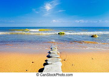 Sandbar - Consecutive series of boulders receding into the ...