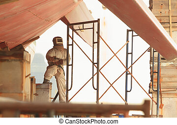 Sandblasting of metal structures at construction site