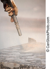 sandblasting - Sandblasting of metal structures at...