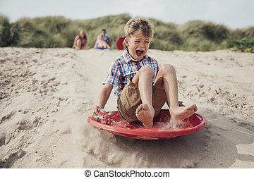 Sandboarding Down the Dunes