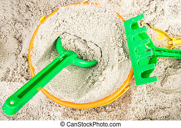 Sandbox with colorful Toys in Detail