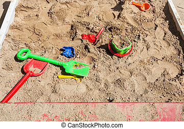 sandbox with toys on children playground