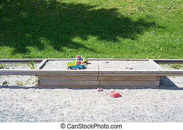 Sandbox with toys on top. Closeable.