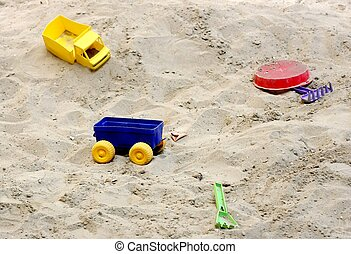Sandbox with toys - Plastic toys for kids in the sandbox.