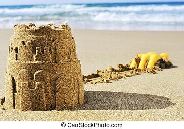 sandcastle on the sand of a beach