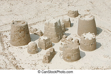 small brown sand castle on the beach