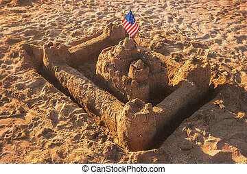 Sandcastle with USA flag.