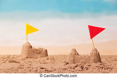 Sandcastles with checkboxes close-up on background of the sea.