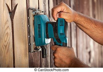 sander, elektrisch, -, arbeider, vibreren, closeup, handen, gebruik