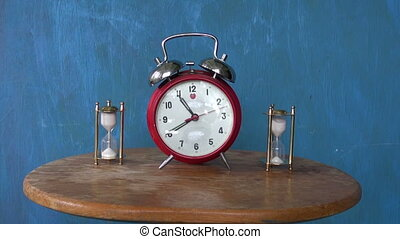 sandglass and vintage alarm-clock