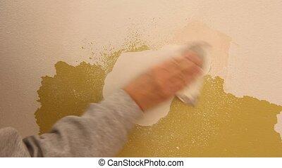 wall repair - sanding a wall repair