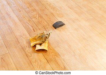 Sanding floor with a sanding block, home DIY project