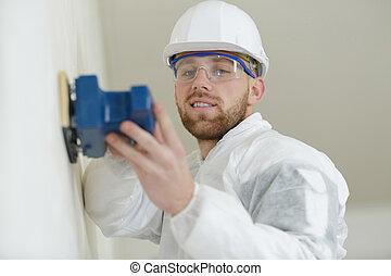 sanding the wall