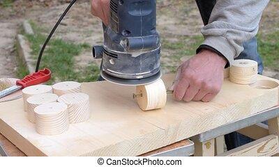 Sanding using a random orbital dual-action sander - Hands...