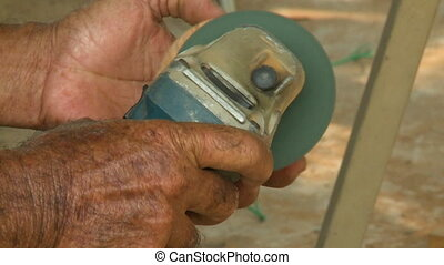 Sanding Wooden Circular Block - Handheld, close up shot of a...