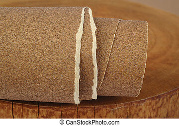 Sandpaper on wooden background