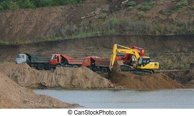sandpit - loader dump tipper loads of sand