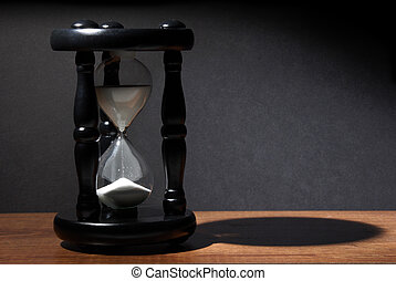 The sands of time trickle through this hourglass.