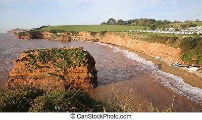 Sandstone rock stacks Ladram Bay beach Devon England UK pan